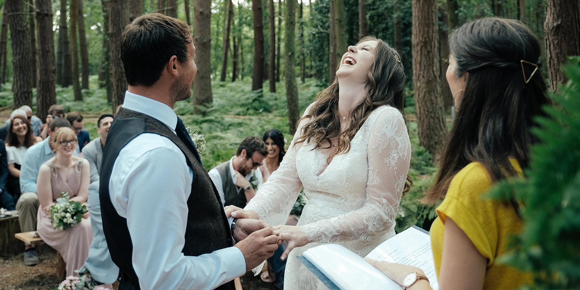 Laughing couple during wedding ceremony | Humanist Wedding Celebrant Laura Gimson