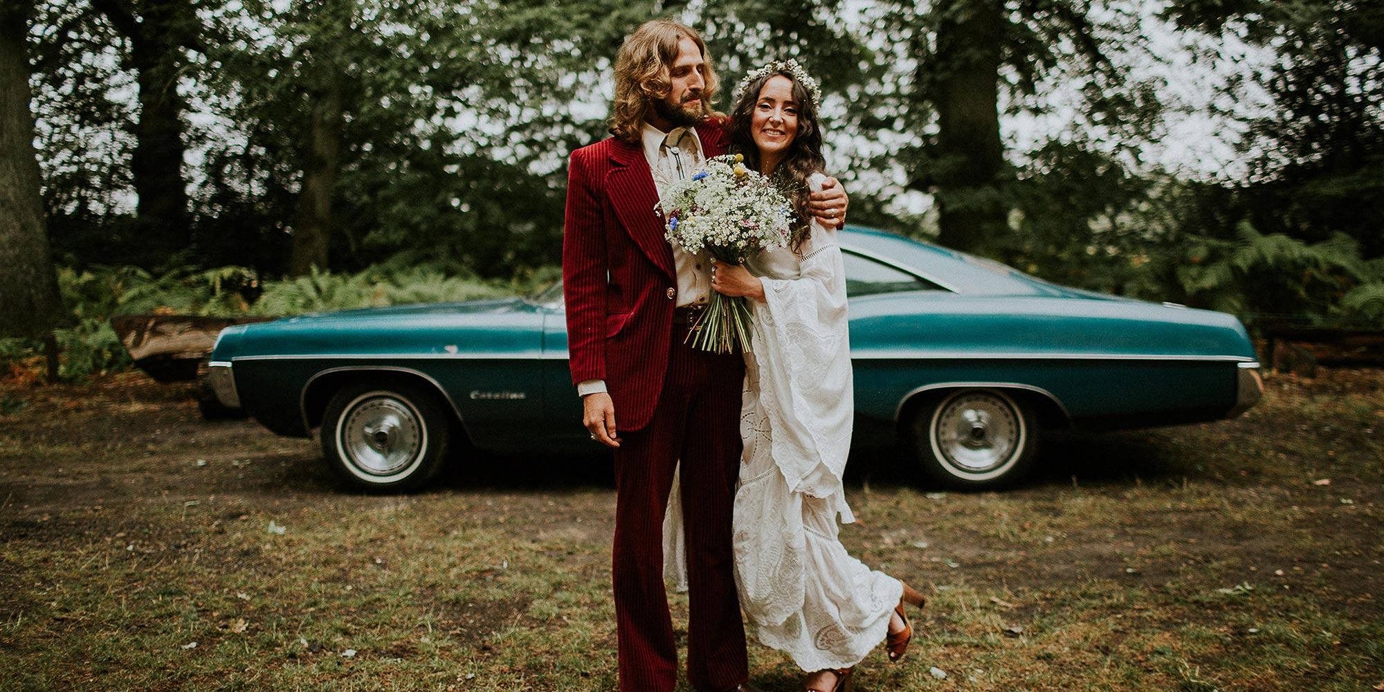 Just married couple with vintage car in background | Humanist Wedding Celebrant Laura Gimson